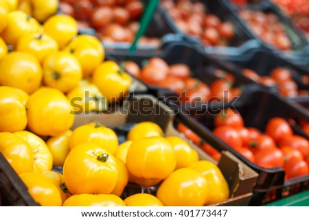 Crates full of ripe tomatoes in the supermarket. Vegetable store background - stock photo