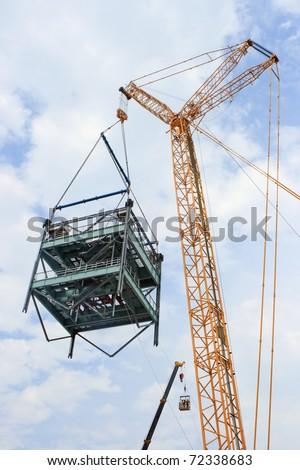 Crawler Crane super lift over 100 ton, smaller crane in background - stock photo