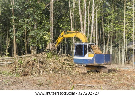 Crawler dozer working in the construction site - stock photo
