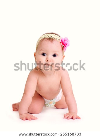 Crawling baby girl with flower isolated on white background - stock photo