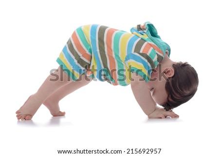 Crawling Baby Looking Backwards Isolated on White Background - stock photo