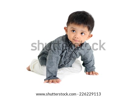 Crawling indian baby - stock photo