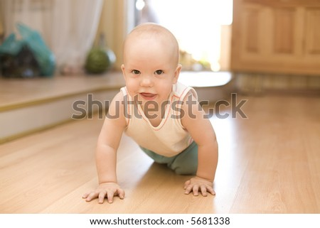 Crawling little baby - stock photo