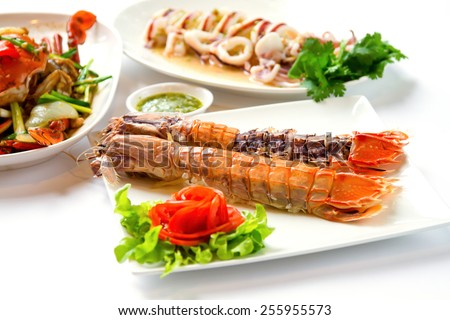 crayfish on white dish served with dipping sauce. - stock photo