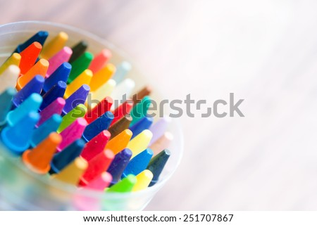 Crayon abstract. Vivid and strong colored crayons fading into bright white light.  - stock photo