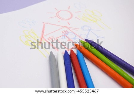 Crayon Drawing by a kid with colorful crayons - stock photo