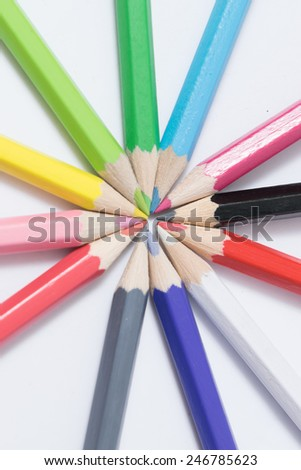 Crayons. Colored Pencils. Colored pencils isolated white background and wood chips - stock photo