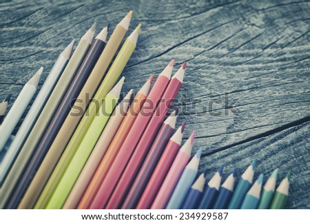 Crayons on wooden table background  - stock photo