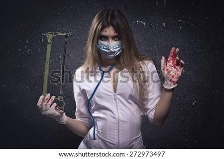 Crazy bloody nurse in a dark room - stock photo
