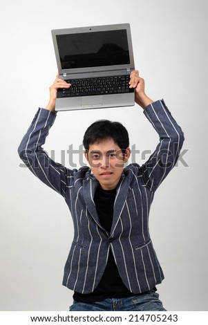 Crazy Business man with worn-out laptop - stock photo