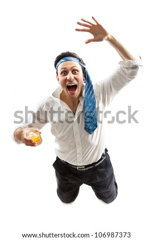 Crazy businessman celebrating with a glass of whiskey - stock photo