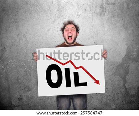 crazy businessman holding poster with falling oil chart - stock photo