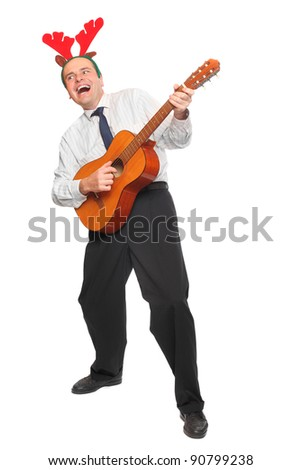 Crazy businessman with guitar singing. Christmas and new year party concept. - stock photo