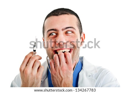Crazy doctor looking at a syringe - stock photo