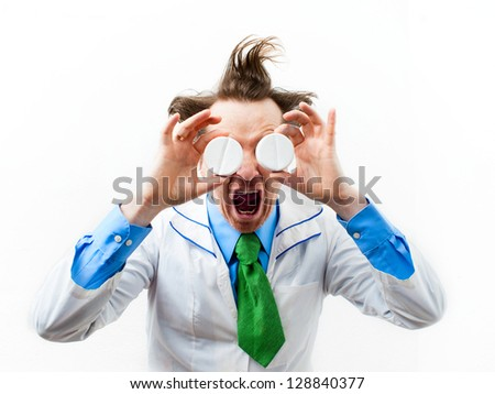 Crazy doctor with pills in hand - stock photo