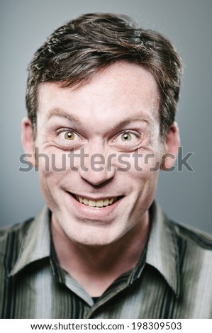 Crazy faced Caucasian man making a face - stock photo