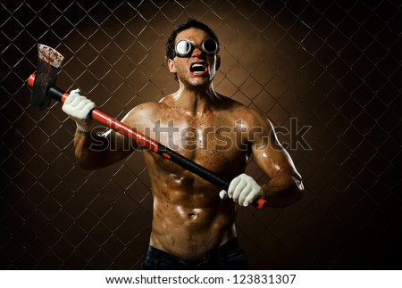 crazy frenzied chopper  butcher man covered with blood,  action with big axe - stock photo