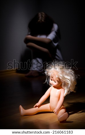 Crazy girl and plastic doll - stock photo