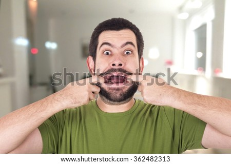 Crazy guy opening mouth - stock photo
