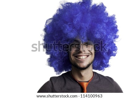 Crazy guy with blue wig on white background - stock photo