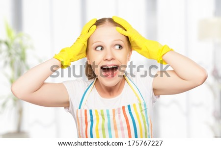 crazy housewife screaming and holding his head with hands - stock photo