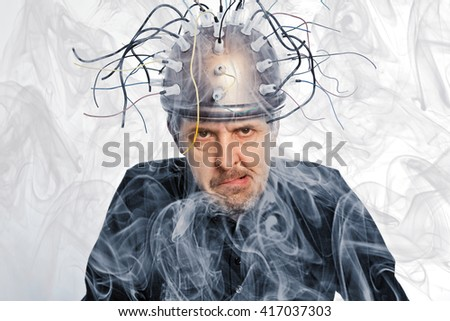 Crazy inventor of a helmet for brain research - stock photo