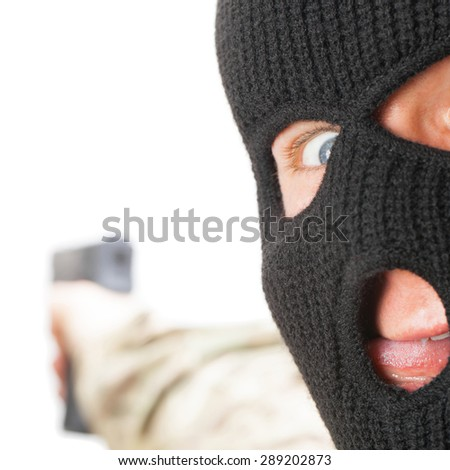 Crazy man in mask holding gun - close up - stock photo