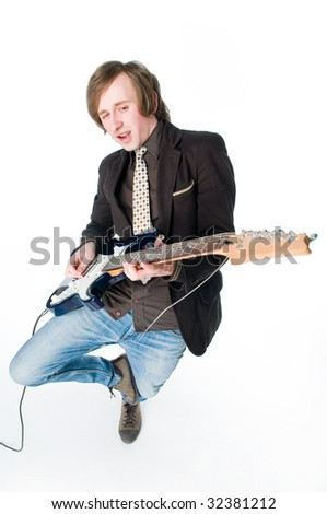Crazy man playing electro guitar, high angle view - stock photo