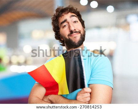 crazy man with flag. airport background - stock photo