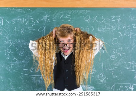 Crazy nerd blond student girl holding hair surprised expression in green chalk board - stock photo