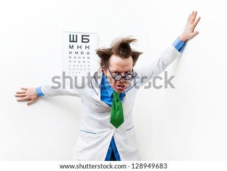 Crazy optometrist in the white coat - stock photo