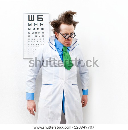 Crazy optometrist in the white coat - stock photo