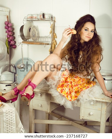 crazy real woman housewife on kitchen, eating - stock photo