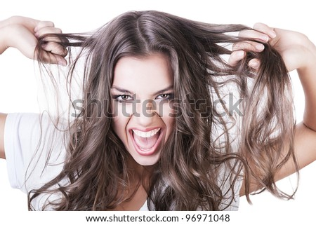 crazy sexy woman with long hair on white background - stock photo