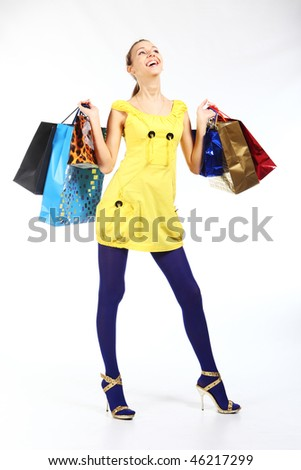 Crazy shopping. Happy girl with Shopping Bags. - stock photo