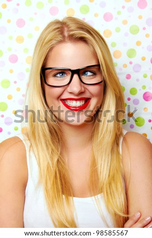 crazy young blond woman against a background with dots - stock photo