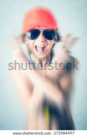 crazy young lifeguard boy - blurred style photo - stock photo