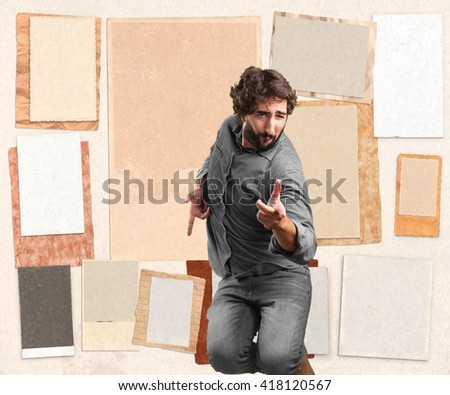 crazy young man jumping. happy expression - stock photo