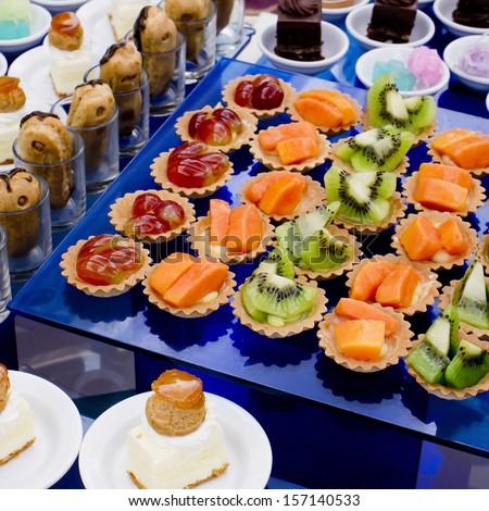 Cream and fruit dessert close up - finger food - stock photo