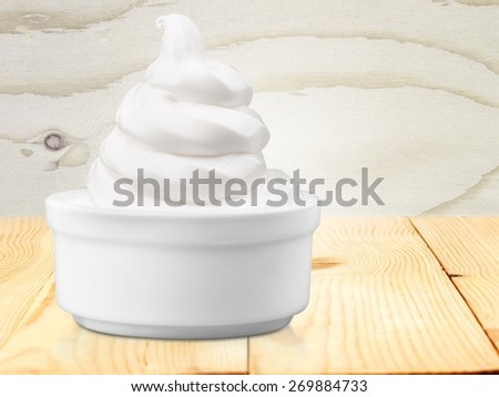 Cream. Blank Paper Cup With Vanilla Soft Ice Cream On White Background - stock photo