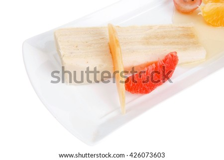 cream cake and fruits served on white plate - stock photo