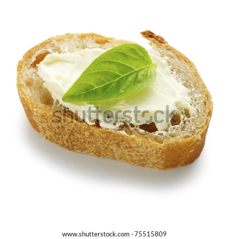Cream-cheese and basil on french bread - stock photo