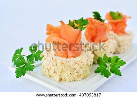 Cream cheese roll canapes with smoked salmon - stock photo