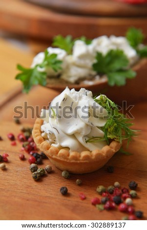 cream cheese with fresh herbs on tartelette - stock photo