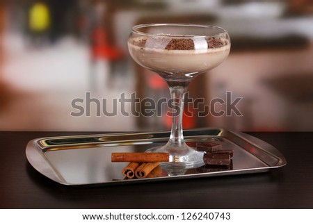 Cream cocktail on table in cafe - stock photo