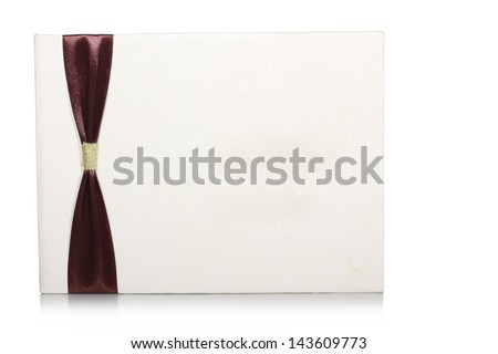 cream-colored invitations and there is a red ribbon, isolated on white background - stock photo