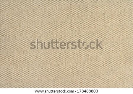 Cream coloured canvas texture paper background - stock photo