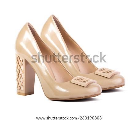 Cream female shoes isolated on white background - stock photo