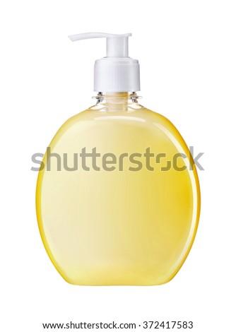 Cream liquid soap / studio photography of transparent bottle with yellow liquid - isolated on white background - stock photo
