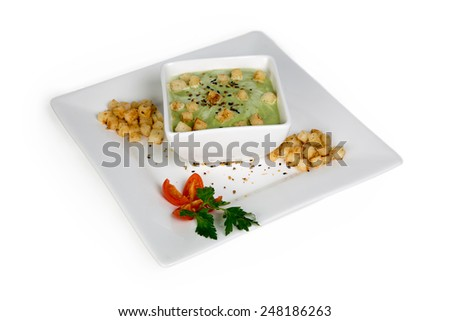 cream of broccoli soup isolated - stock photo
